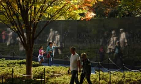Visitors walk through the Korean War Veterans Memorial after it was reopened to the public in Washington.