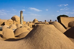 Iran Tourism Push: Cupolas of the baazars, a minaret and a windcatcher in Yazd Province