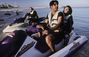 Iran Tourism Push: A man and a woman jetski together, unthinkable a few years ago