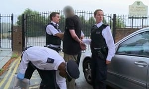 Police officers arrest a suspect in a still from Ben Ferguson's video