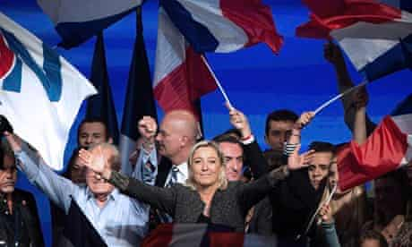 Marine Le Pen surrounded by supporters with flags