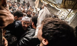 Syrians jostle for food at a UN aid station Aleppo