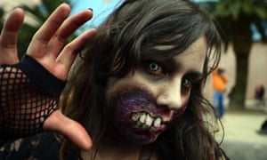 "A woman dressed up as a zombie takes part in a ""Zombie Walk"" at the Revolution Monument in Mexico City on November 3, 2012. According to organizers, 15,000 people will take part in the event in an attempt to set a new Guinness record.  AFP PHOTO/Alfredo EstrellaALFREDO ESTRELLA/AFP/Getty Images HORIZONTAL"