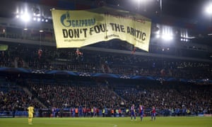 Greenpeace activists hold a demonstration against Champions League sponsor Gazprom last night to draw attention to the incarceration of 30 protesters being held by the Russian government. The action delayed the beginning of the game between FC Schalke and Basel FC.