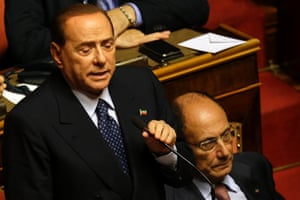 People of Freedom party leader Silvio Berlusconi delivers his speech at the Senate, in Rome, Wednesday, Oct. 2, 2013.