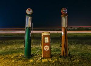 Nightwatch: Vintage gas pumps in Salado, Texas. July 2009