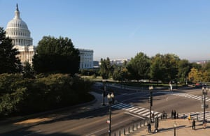 A few pedestrians wait to cross the street to the U.S. Capitol in Washington, October 2, 2013.
