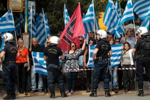 Ultra-right wing party Golden Dawn supporters gather outside the Athens' courthouse, as they wait for the transfer of Golden Dawn leader Nikolaos Michaloliakos to the prosecutor, in Athens, Greece, 02 October 2013.