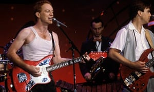 Danny Elfman on stage with Oingo Boingo in 1982