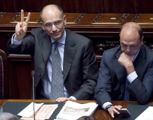Italian Prime Minister Enrico Letta (L) gestures next to Italian Interior Minister Angelino Alfano at the lower house of Parliament in Rome, Italy, 02 October 2013.