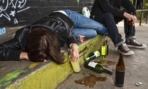 Drunk teenager on the pavement