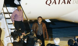 The two Turkish pilots, Murat Agca and Murat Akpinar, leave the plane after landing in Istanbul.