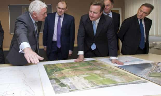 From left to right: Nigel Cann site director of Hinkley Point C, Ed Davey, David Cameron, Vincent de Rivaz, Chief Executive of EDF (Electricite de France) and Henri Proglio, CEO and Chairman of EDF, examine site plans for Hinkly C nuclear power station at Hinkley Point.