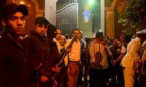 Egyptian security forces stand guard outside the Coptic Christian church attacked by gunmen