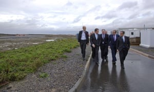 Ed Davey (second from right) with David Cameron and EDF executives at the site of a planned new nuclear power station at Hinkley Point in Somerset.