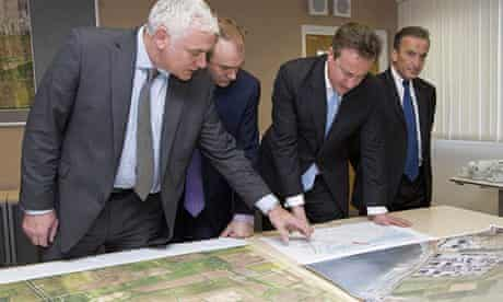 David Cameron is shown plans for Hinkley Point C