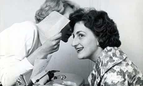 1960 Girls gossiping in the office