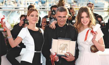 Exarchopoulos, Seydoux and their director, Abdellatif Kechiche, with their Palme d'Or at Cannes.