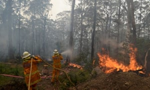 New South Wales Rural Fire Service crews protect a property on Bulgamatta Road in the township of Berambing in the Blue Mountains.