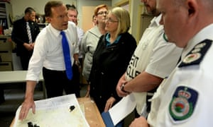 Part of Australian life: Tony Abbott and the federal MP for Macquarie, Louise Markus, are briefed by Rural Fire Service incident controller David Jones (second right) and RFS commissioner Shane Fitzsimmons.