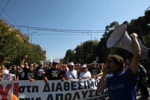 """School guards hold a banner reading """"No"""" during a rally on October 22, 2013 in Athens, Greece.  About 600 school guards and their supporters, who were dismissed over the summer, walked some 560 kilometers (350 miles) from the northern Greek port city of Thessaloniki to the Greek capital to attend a rally."""