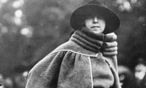 Woman wearing cape coat with bolster-like high collar, circa 1914