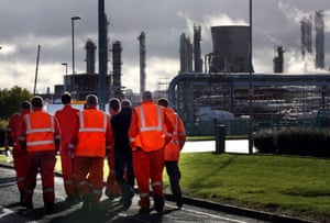 Workers walk through the Grangemouth oil refinery in Falkirk, Scotland.