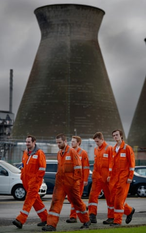 Workers from Grangemouth chemical plant make their way to a staff meeting on October 23, 2013 in Grangemouth, Scotland.