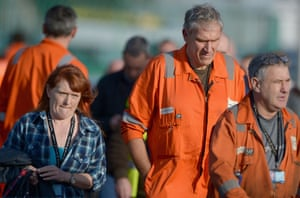 Workers from Grangemouth chemical plant make their way from a staff meeting on October 23, 2013 in Grangemouth, Scotland.