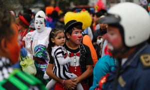 A clown with his little clown daughter waits for the start of a laugh-a-thon world record attempt at the 17th International Clown Convention in Mexico City. There was no last laugh, sadly, the attempt fell short by 15 minutes.