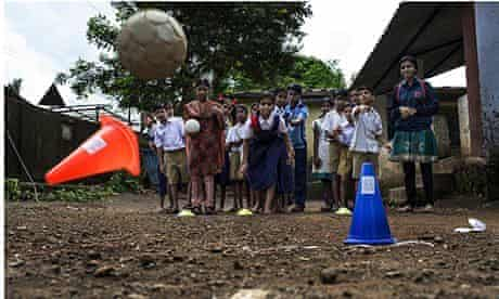 A Magic Bus peer leader runs an activity at Manjarli village school