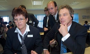 Tony Blair listens to calls at an NHS Direct call centre
