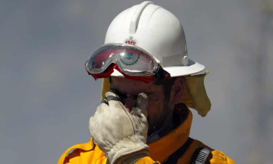 Weather improving: A Rural Fire Service crew member at Bilpin in the Blue Mountains.