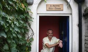 Donnachadh McCarthy outside his retrofitted eco home in London