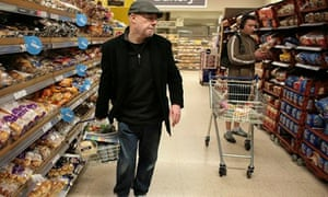 Nigel Leigh looks for a bargain at a Tesco store in London