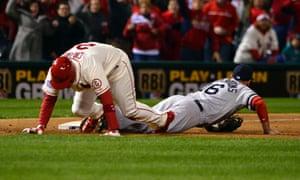 St. Louis Cardinals' Allen Craig trips over Boston Red Sox third baseman Will Middlebrooks