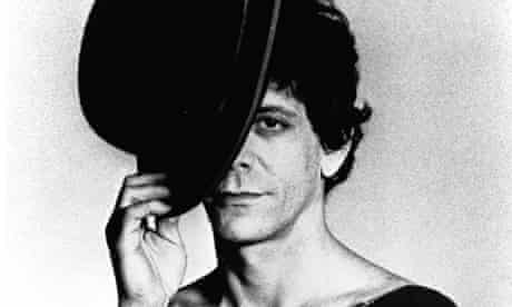 FILE - OCTOBER 28, 2013:  Rolling Stone has reported the death of rock musician Lou Reed, aged 71. Reed was best known as guitarist, vocalist and songwriter of the influential 1960s band The Velvet Underground. NEW YORK - CIRCA 1976:  Lou Reed poses for the cover session for his album Coney Island Baby circa 1976 in New York City (Photo by Michael Ochs Archives/Getty Images) Cover People Event Hat Vertical Studio Shot Looking At Camera Black And White Bow Tie Head And Shoulders USA New York City One Person Adult Music Tipping Hat One Man Only Portrait Photography Fashion Adults Only Lou Reed Arts Culture and Entertainment Headshot Album Title Coney Island Baby