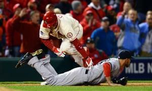 St. Louis Cardinals Allen Craig trips over Boston Red Sox third baseman Will Middlebrooks