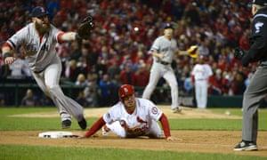 Boston Red Sox pitcher Koji Uehara and first baseman Mike Napoli pick off St. Louis Cardinals baserunner Kolten Wong