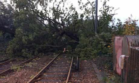 Fallen trees block a railway line at Keymer, West Sussex