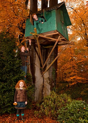 Big Pic - Red Hair: pic of treehouse with girl at bottom of tree and boy at top