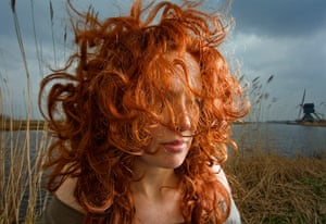 Big Pic - Red Hair: woman with red hair with dutch landscape in background