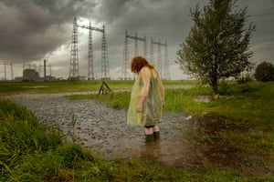 Big Pic - Red Hair: woman with red hair standing in flooded landscape