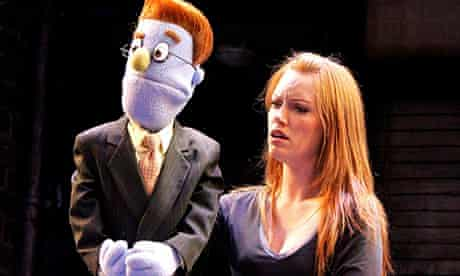 Performer and puppet in Avenue Q