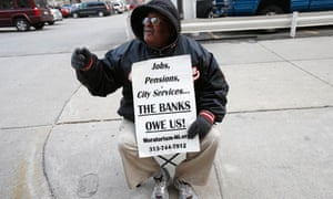 A pensioner protests pensions cuts in Detroit