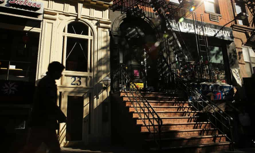 A pedestrian walks by the former site of the rock club The Dom, where the Velvet Underground was the house band on October 28, 2013 in New York City.