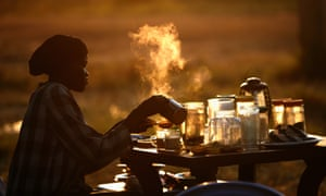 Good morning: A woman prepares hot drinks at an outdoor coffee shop near a polling station in Abyei, Sudan.