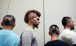 """Models with designs cut into their hair during a """"Free4All"""" hair cutting contest at the Mane Stream Hair and Beauty Expo at the Tampa Convention Centre, Florida."""