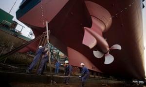 Workers prepare the Stril Luna at Gondan Shipyard's dry-dock in Figueras Port, Spain.