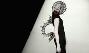Halloween headgear:  A model during the Hu Sheguang Haute Couture Collection at China Fashion Week in Beijing.